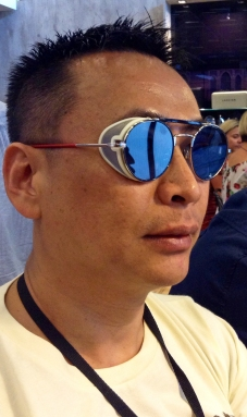 Group manager Ben Chan at Silmo 2013 sporting Thom Browne's TB001, made famous by Lady Gaga and its signature side mesh caps.