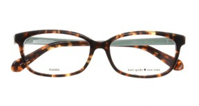 "Kate Spade - Jazmine [Yellow Tortoise]. Features preppy vintage shape in handmade acetate with the phrase, ""boys make passes at girls in glasses"" on the inside arm, and Kate Spade logo."