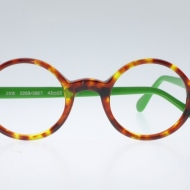 Wissing [2515/2269/2827]. Features circular shape in gorgeous havana with bright green temples.